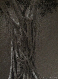 Sketching a tree trunk on grey hand made paper using charcoal and white pastel pencil. By Manju Panchal