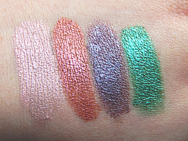 Urban Decay Moondust palette wet swatches of Specter, Element, Magnetic, and Lightyear.