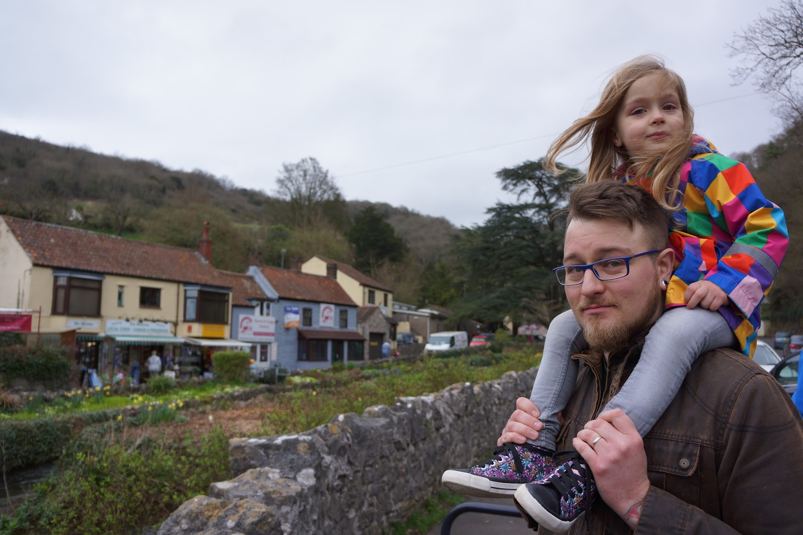 Girl on daddy's shoulders at Cheddar town