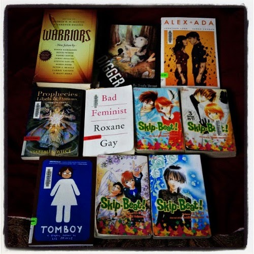 Ten books layed out on a bed. The titles are listed below.