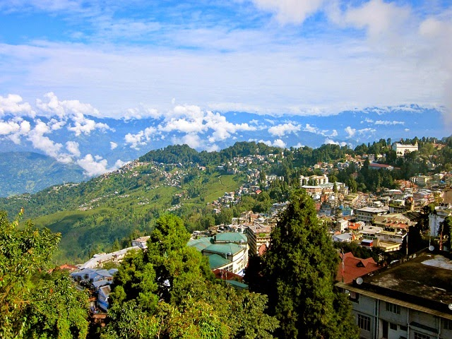 A magical view of the town with mighty Himalayas in the background