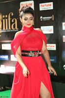 Apoorva in a Stunning Tight Leg Split Sleeveless Red Gown at IIFA Utsavam Awards 024.JPG