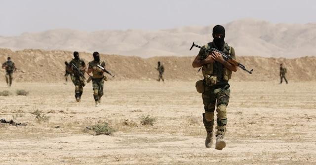 Milícias xiitas do Iraque estavam reunindo tropas nesta segunda-feira para cortar as rotas de suprimento remanescentes para Mosul