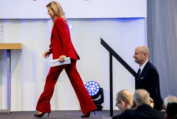 Queen Maxima wore a red blazer and trousers by Claes Iversen, and red blouse by Claes Iversen, with her L.K. Bennett pumps. at trade conference