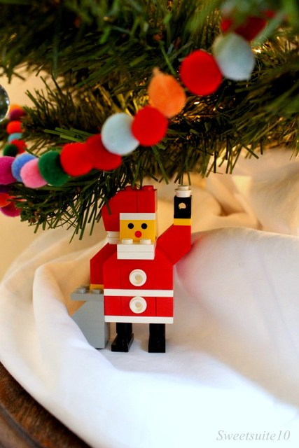 vintage Lego Santa below a Christmas tree