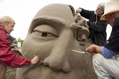 Escultura de arena de cara