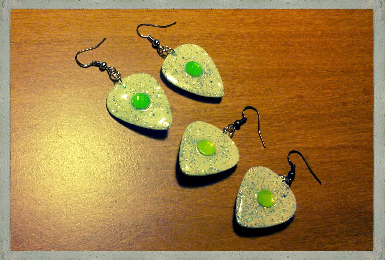 NEW vibrant glow in the dark guitar pick earrings