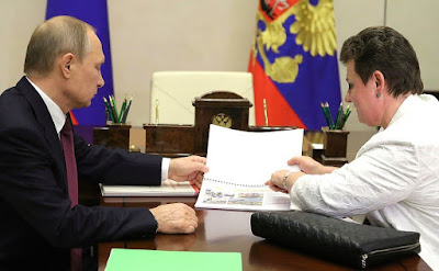 Vladimir Putin with Governor of Vladimir Region Svetlana Orlova.