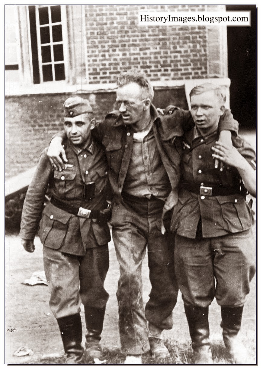 Two German soldiers support  wounded Canadian soldier after Dieppe raid. August 1942.Rare WW2 Images