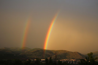 A double rainbow as another storm blows past