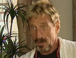 John McAfee accused of murder, wanted by Belize police
