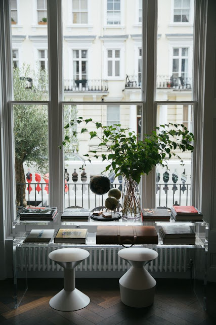 Window overlooking city in guest room at The Laslett Hotel in Notting Hill in the heart of West London