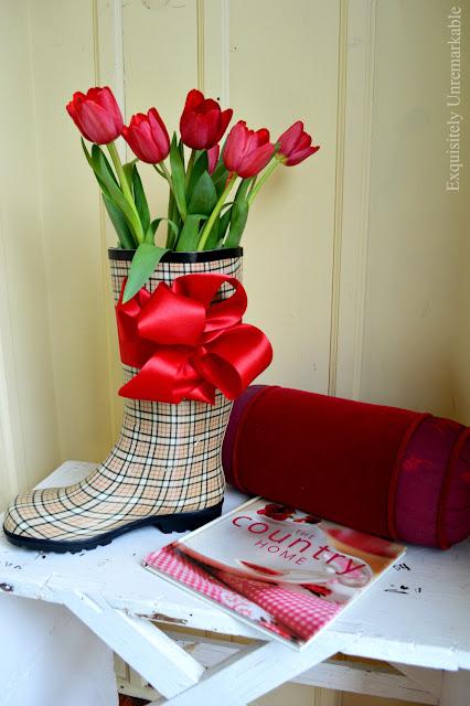 Rain boot tulip arrangement in a mudroom