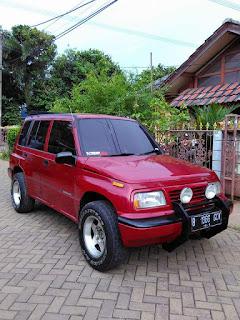 JUAL MOBIL BEKAS :  Suzuki Sidekick Merah Metalik Tahun 1995 Akhir