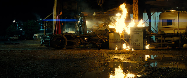 BATMAN V SUPERMAN: DAWN OF JUSTICE BEN AFFLECK as Batman and HENRY CAVILL as Superman face off on the BATMOBILE