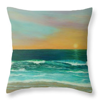 Coastal Throw Pillows of a sunset on  a beach blue and orange