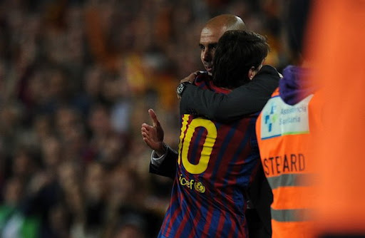 Lionel Messi hugs his Barcelona coach Pep Guardiola after scoring his hat-trick against Espanyol