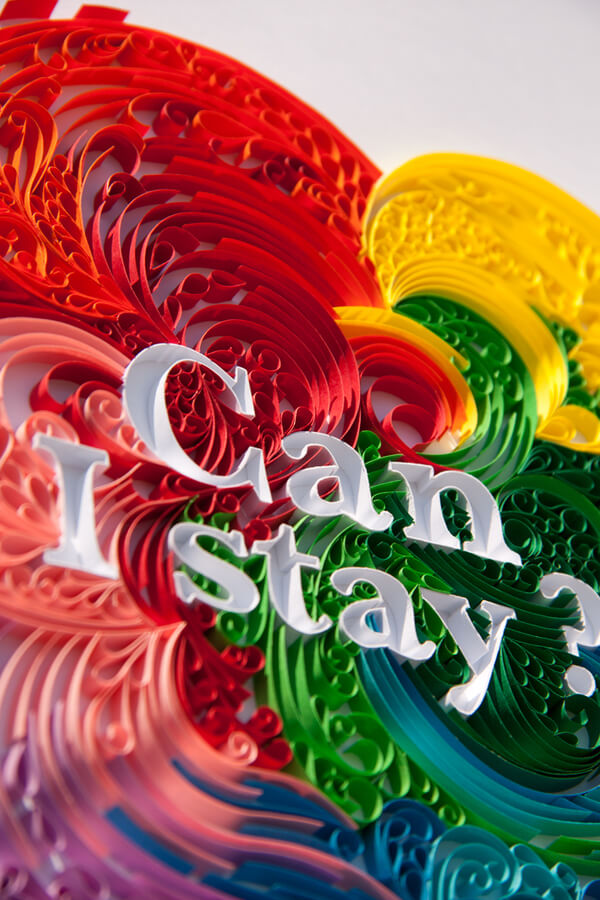 White lettering surrounded by colorful quilling