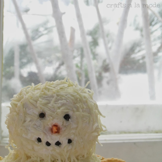 snowman with peppercorn eyes