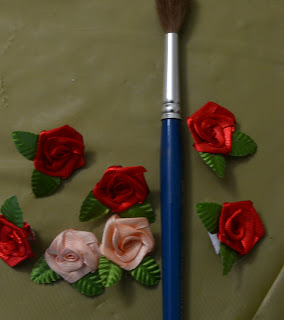 Satin roses with leaves