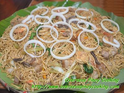 Pansit Lucban topped with  Lechon Kawali - Recipe