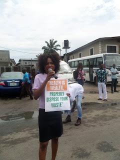 A teacher - Miss Ada sensitizing people around Diobu mile 3 market