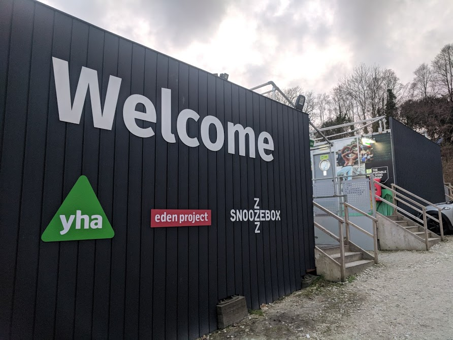 Staying in a Recycled Shipping Container at The Eden Project - YHA Eden Project Review  - welcome sign