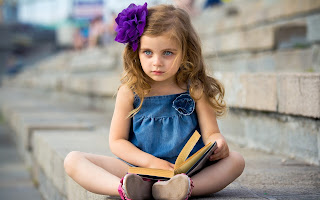 Cute Baby girl reading book