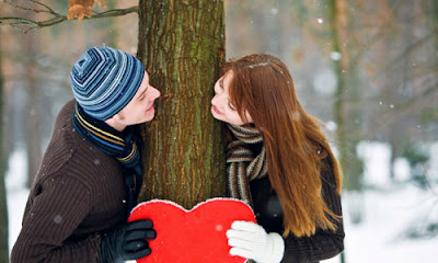 6 Tips to Make Your Friend Fall for you,man woman holding heart tree ice