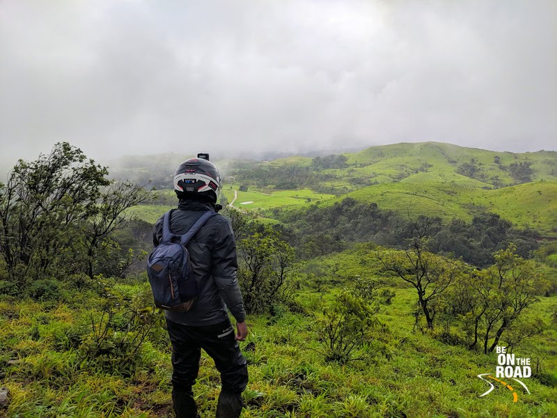 Appreciating the view of the rolling hills at Kaginahare Forest, Karnataka