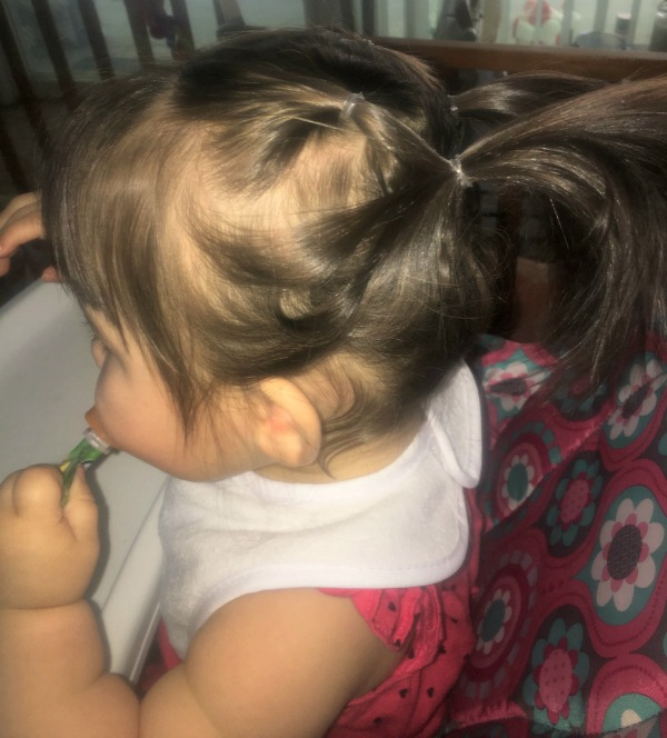 double pony tail on a little girl