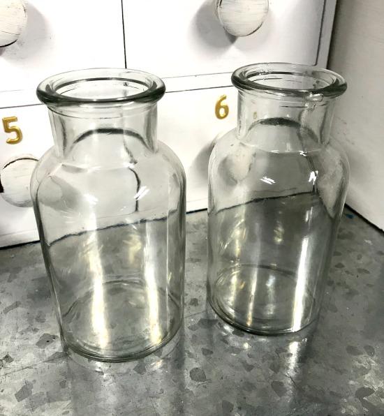 Glass bottles used to make terrarium planters