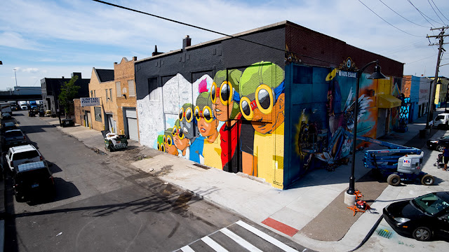 "Chicago's Hebru Brantley has had a busy summer and just finished this piece for ""Murals In The Market"". In Detroit's Eastern Market neighborhood, this massive work is 60x28 and on the corner of Adelade and Russell."
