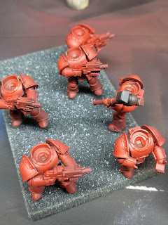 Six marines painted red with contrast.