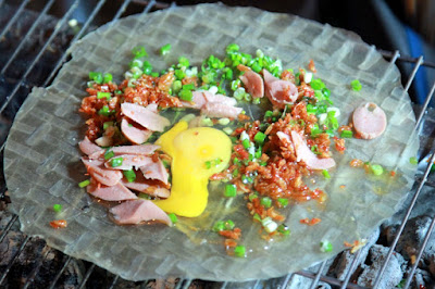 Grilled rice paper with egg - Vietnamese is the most popular street foods in Da Lat city.