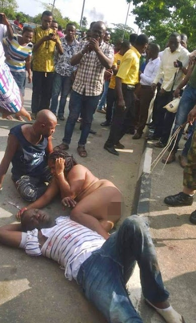 Woman and Two Others Stripped N*ked as Angry Mob Beat Them to Pulp in Lagos... Find Out Why (Photos)