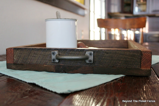metal handles added to a rustic farmhouse tray