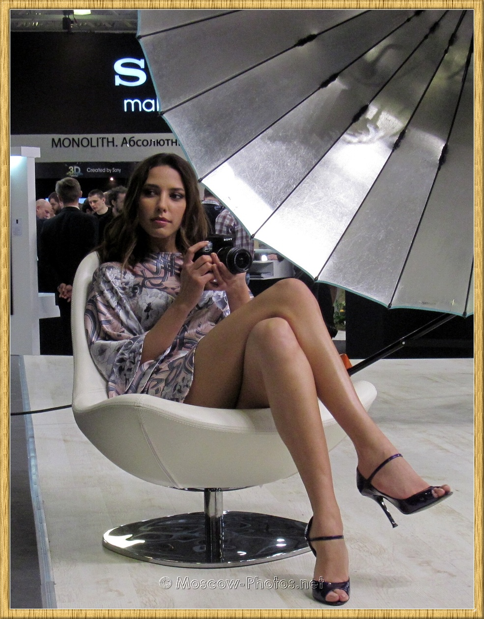 Long Legs Russian Beauty Sitting On A Chair