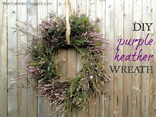 purple heather wreath on fence