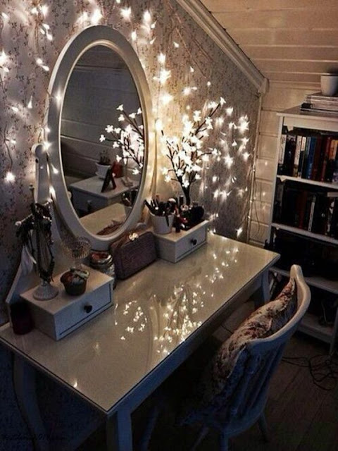 small makeup vanity table with mirror and lights
