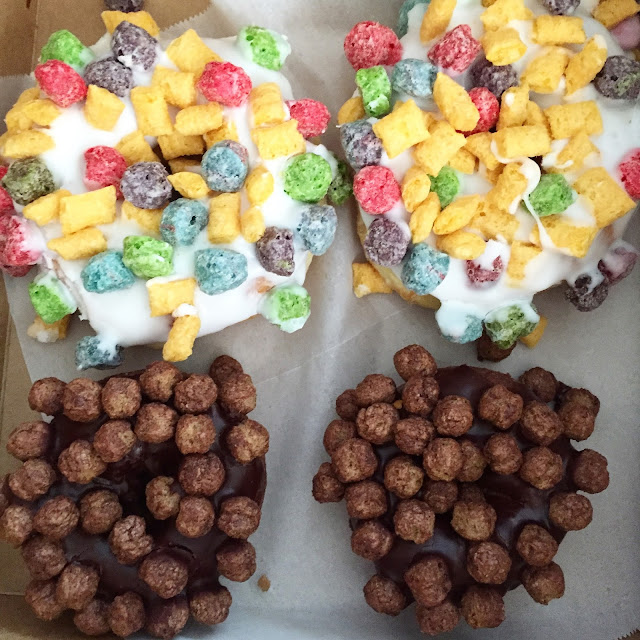 Fruity Pebbles and Cocoa Crisp Doughnuts from Voodoo Doughnuts