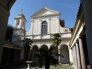 The garden and facade of the Basilica of San Clemente
