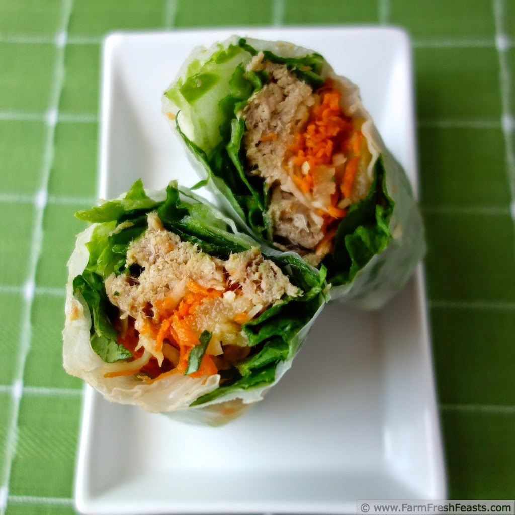 Kalua Pig Summer Rolls with Kohlrabi, Carrots and Pineapple  cut in half to show interior | Farm Fresh Feasts