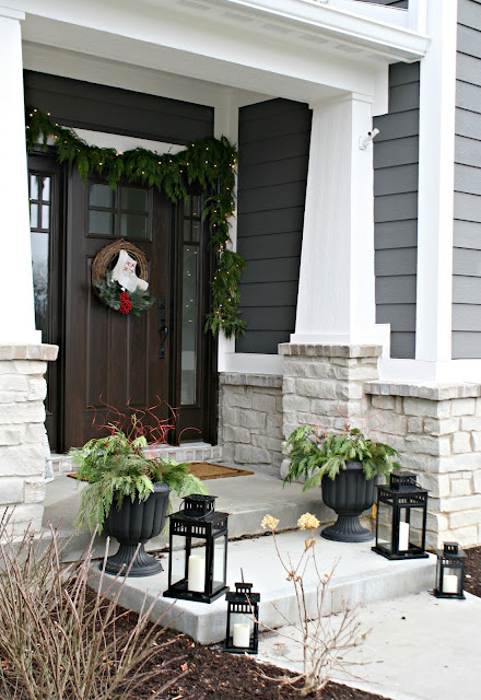 Christmas porch with greenery and lanterns