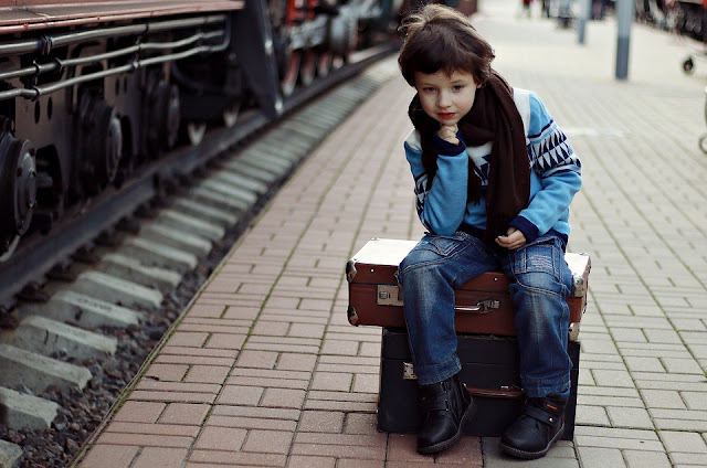 Image: Boy Sitting on Suitcase, by Victoria Borodinova on Pixabay
