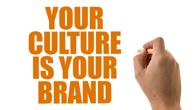 "Image with hand writing ""your culture is your brand"""