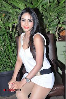 Actress Model Pooja Sri Stills in White Short Dress at F Club pre soft Launch  0090.JPG