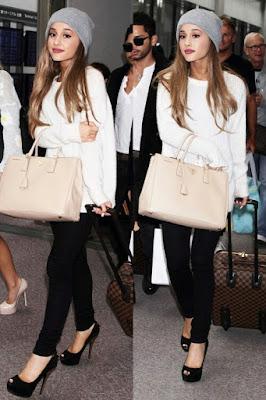 Ariana Grande white sweater, black jeans, cup
