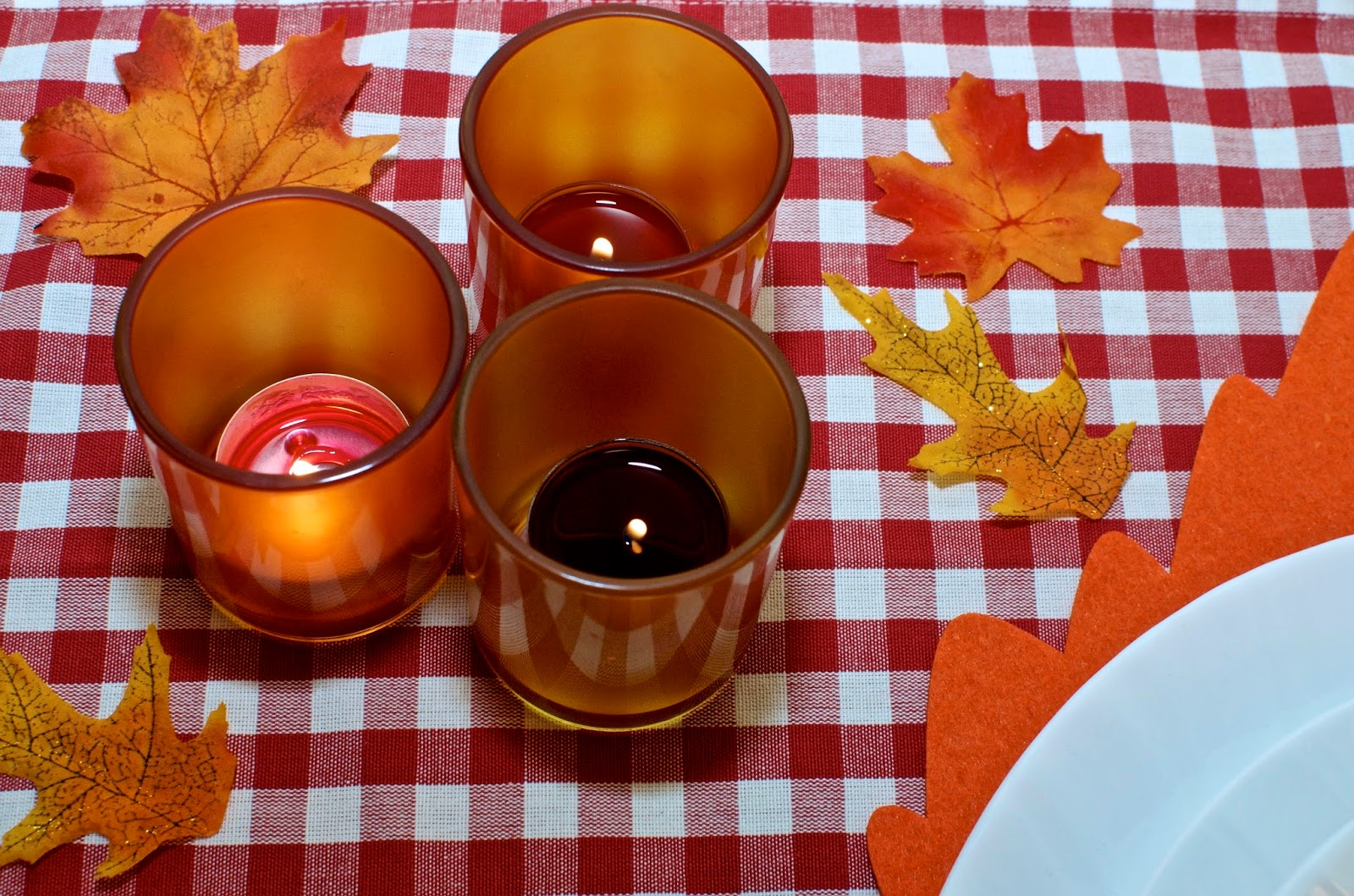 Orange and yellow votive candles