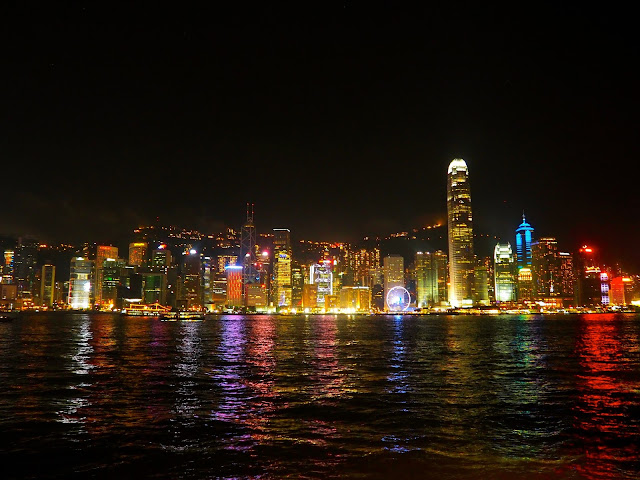 View of Hong Kong Island skyline and Victoria Harbour at night, taken from Tsim Sha Tsui waterfront